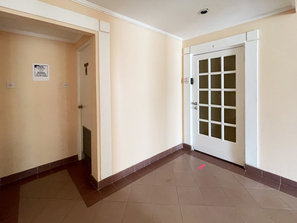 Main entrance door with shared Male & Female bathrooms