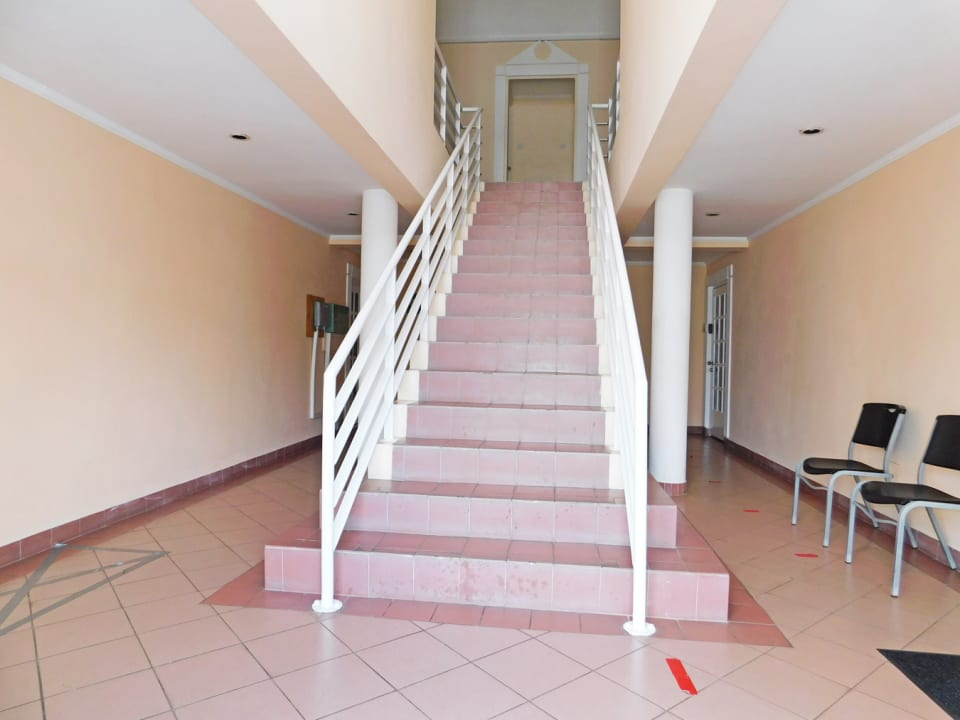 Central steps to additional offices upstairs