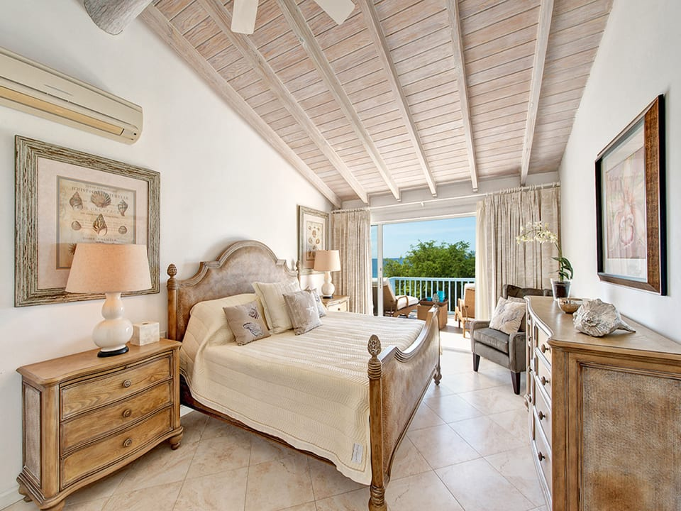 Main bedroom with a private balcony
