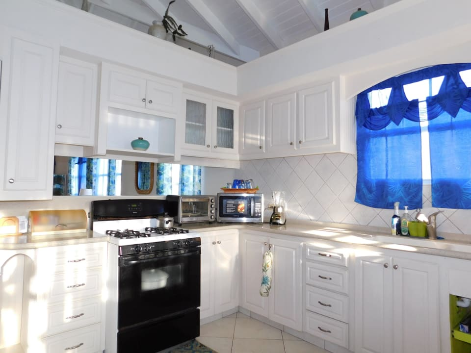 The kitchen overlooks the open plan living and dining room
