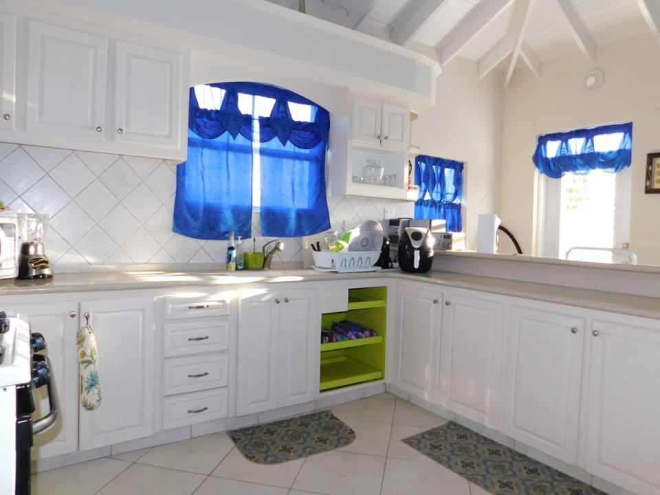 Large kitchen with wooden cupboards and decoran countertops