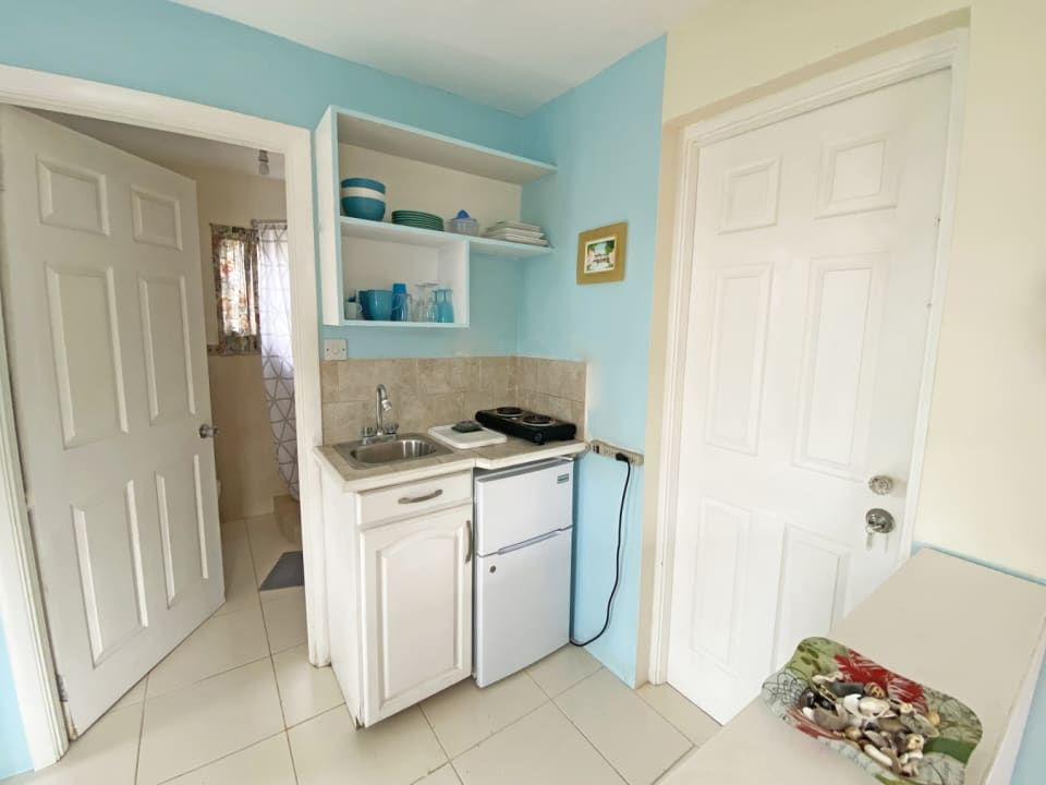 Kitchen which leads into Bathroom