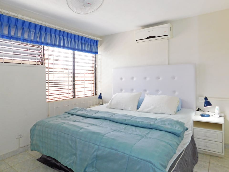 Bedroom 1 with king bed and AC
