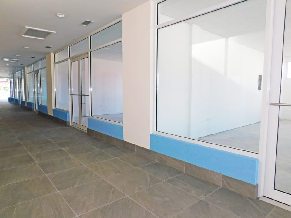 Shell units with concrete floors and drop ceilings
