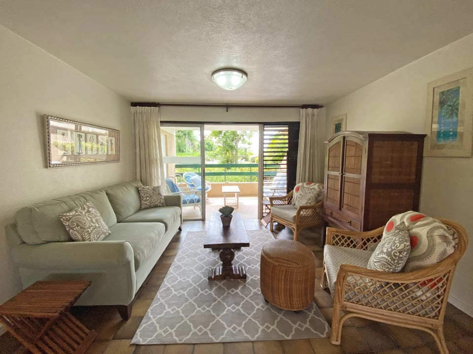 Comfortably furnished living room adjoins terrace