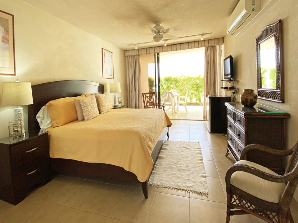 Bedroom with sliding door leading out to patio