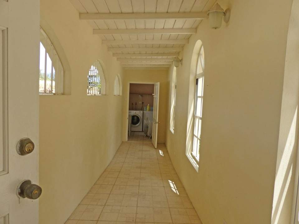 Walkway from the covered Garage towards the kitchen
