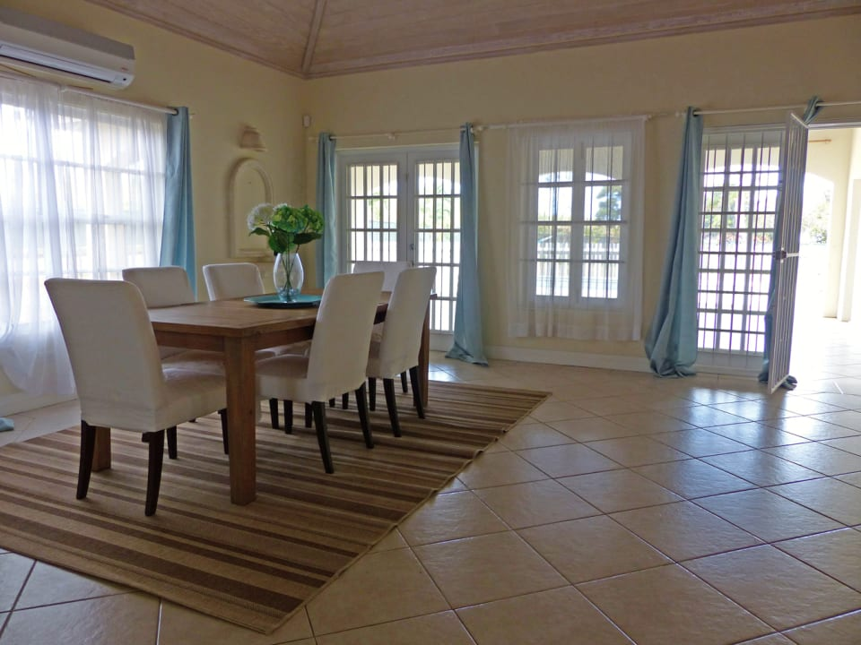 Dining Area opens out to the large pool and deck