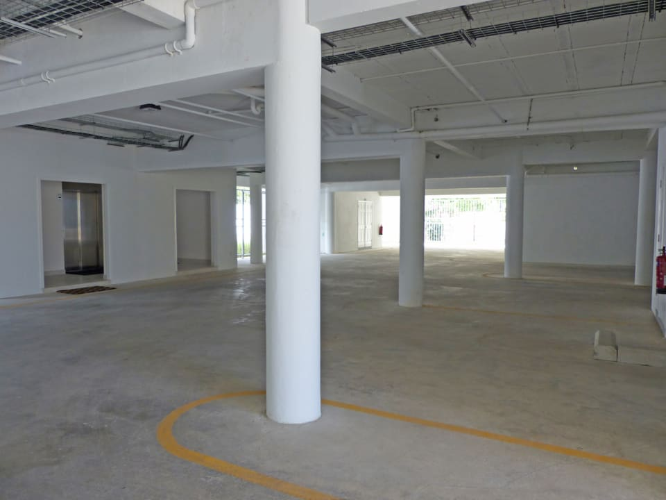 Covered Parking with private storage room and bathroom