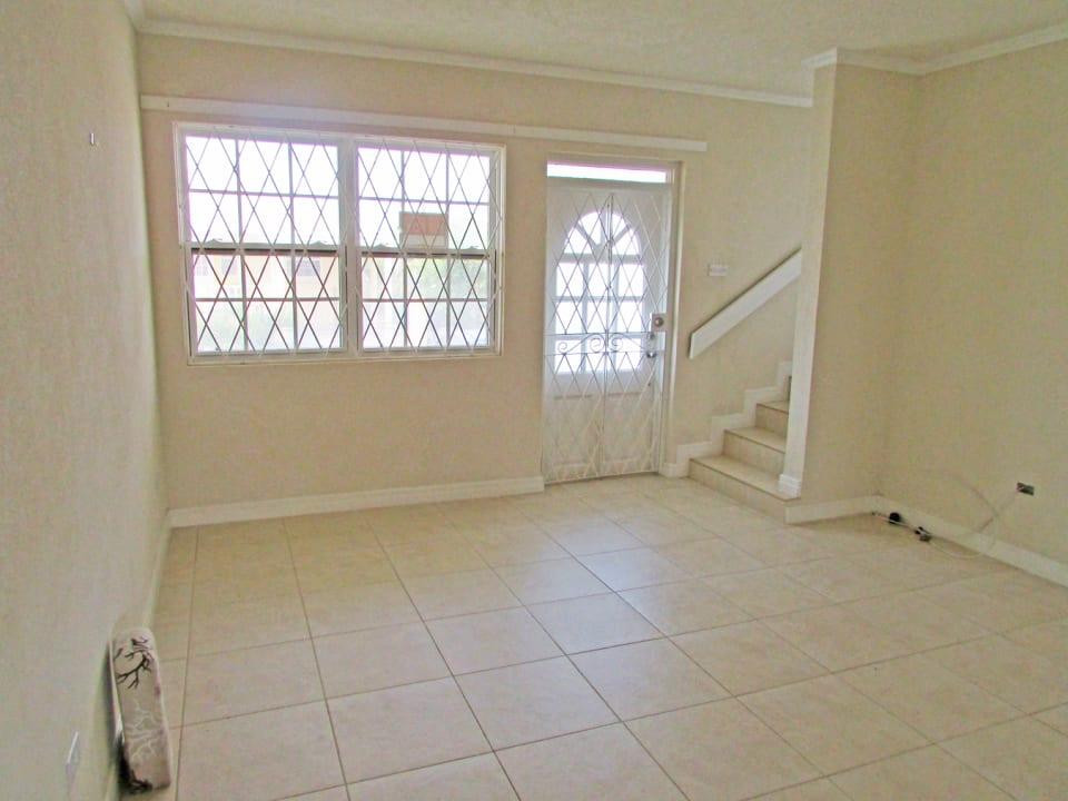 Spacious open plan living. Please note the security grill is no longer there