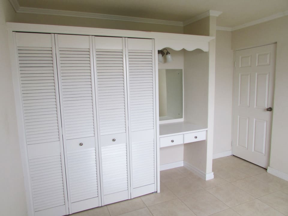 Guest bedroom with built in closets