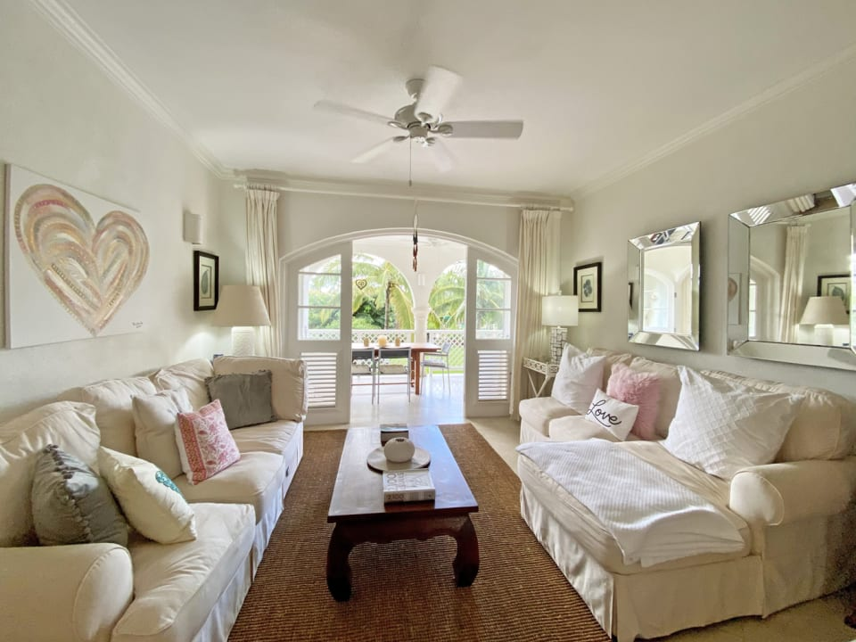Comfortably furnished living room flows onto terrace