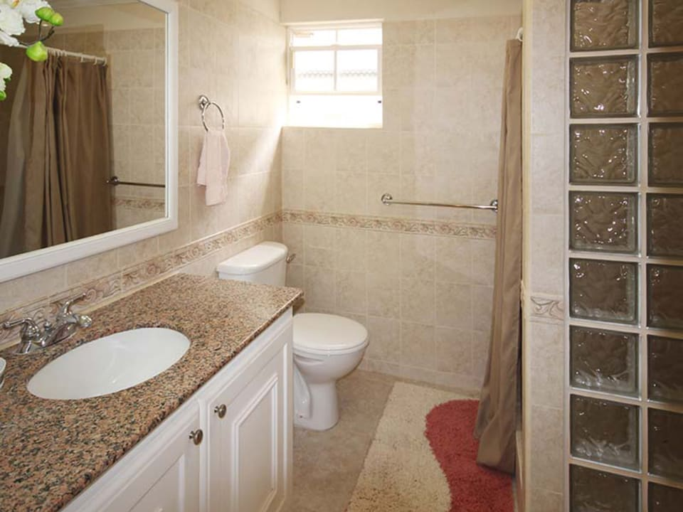 Modern bathroom is En-suite to main and share with bedroom 2
