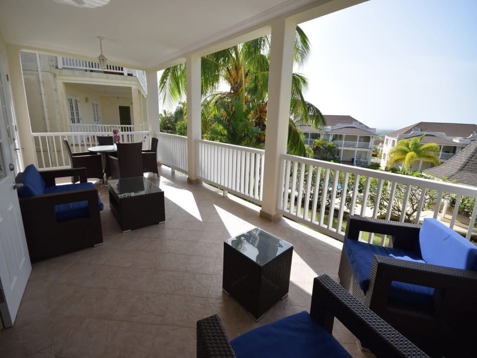Spacious terrace overlooking gardens and pool