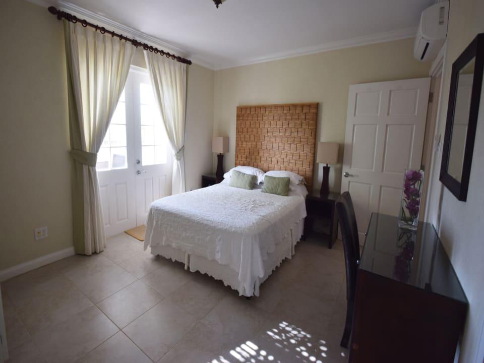 Main bedroom with doors to terrace and en suite bathroom