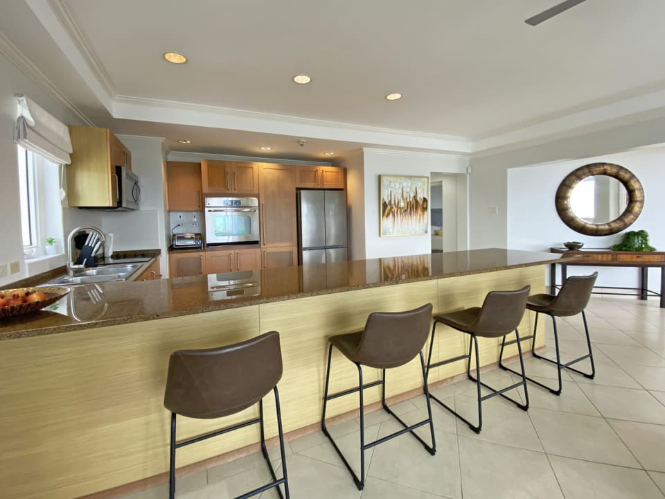Open plan kitchen with breakfast bar