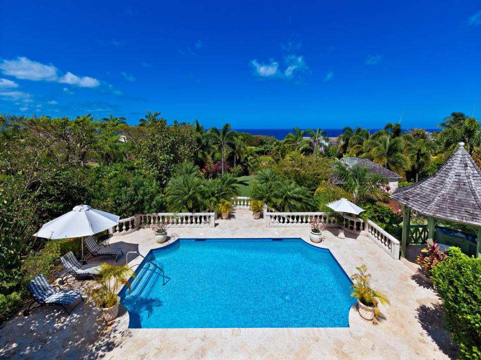 View of swimming pool pagoda and sea beyond