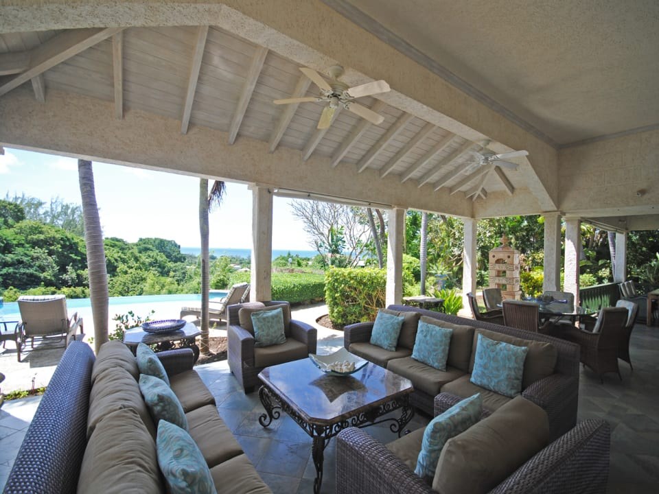Pool and sea views from the covered verandah