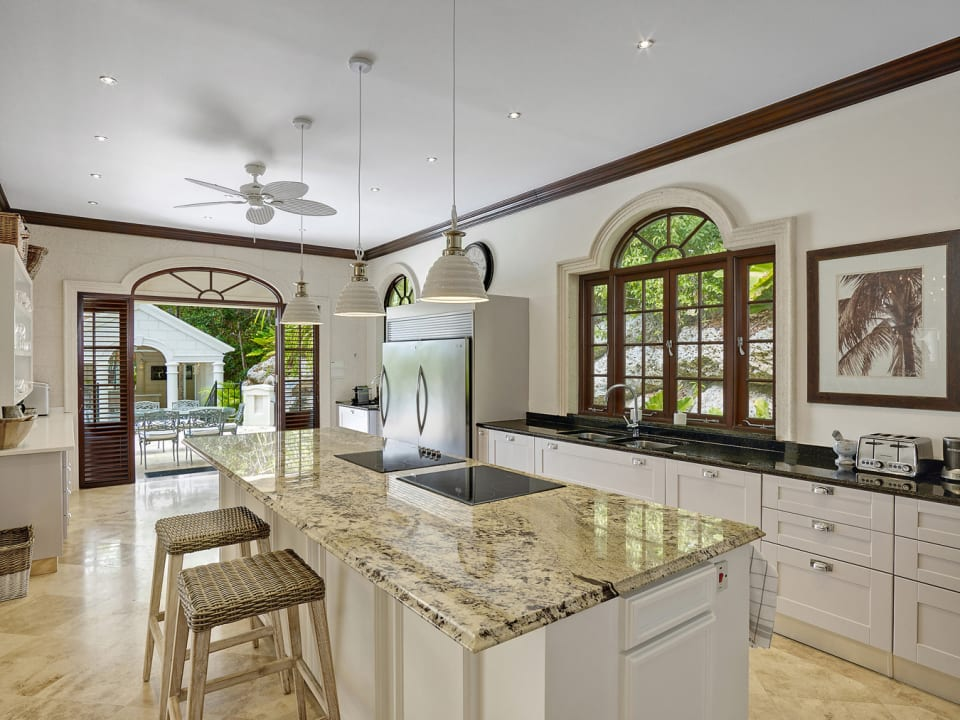 Fully equipped kitchen opens to pool terrace