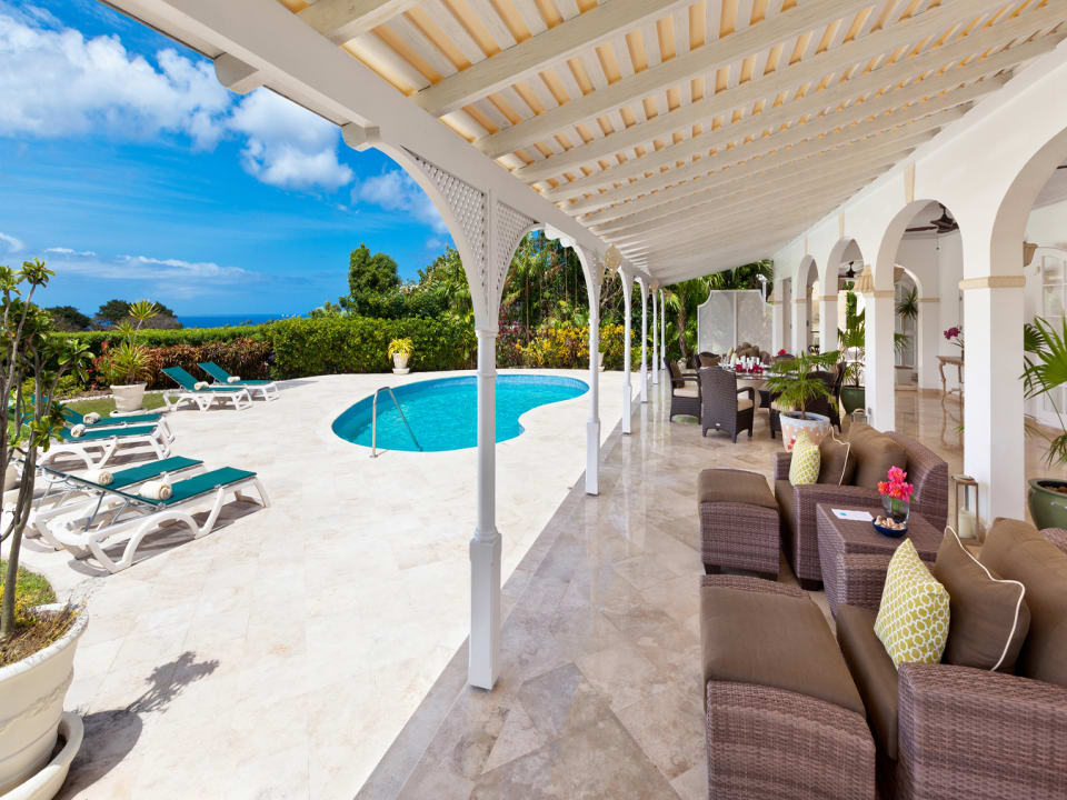Outdoor patio with spacious pool deck