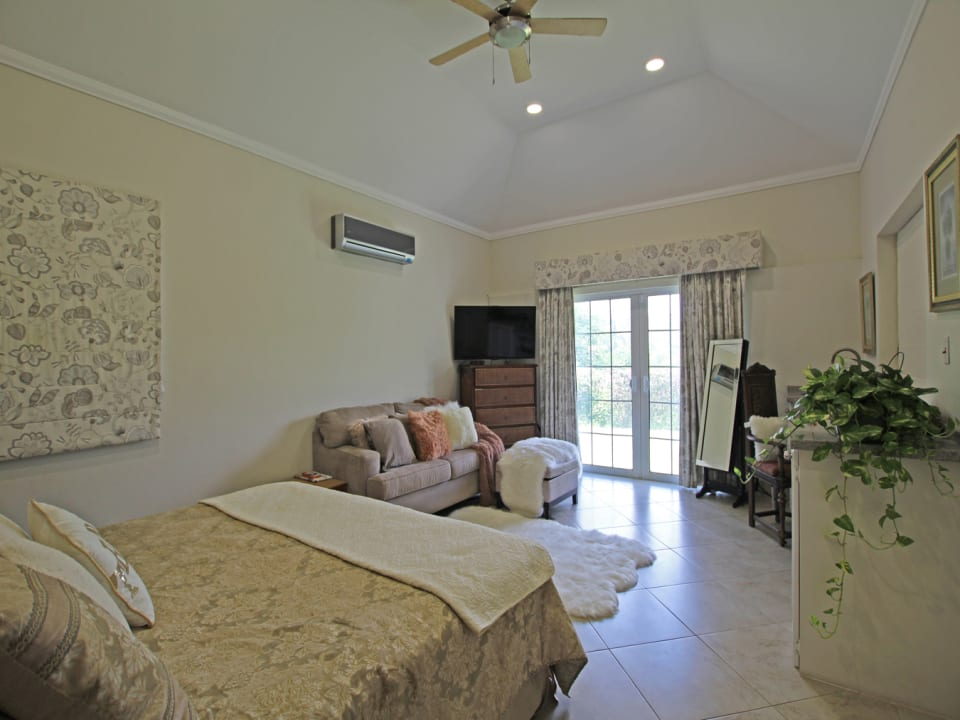 Spacious master bedroom with vaulted ceilings