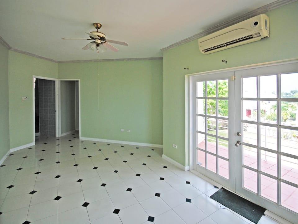 First floor Master bedroom opens to balcony