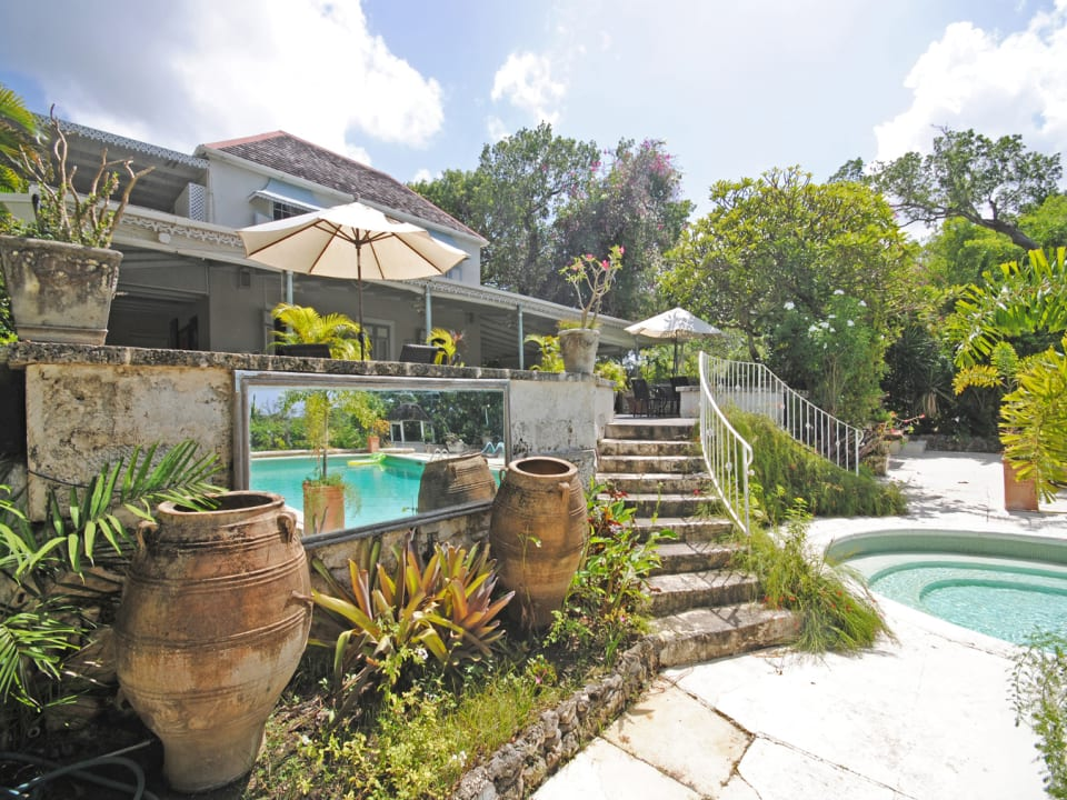 Double stairway connecting house and pool