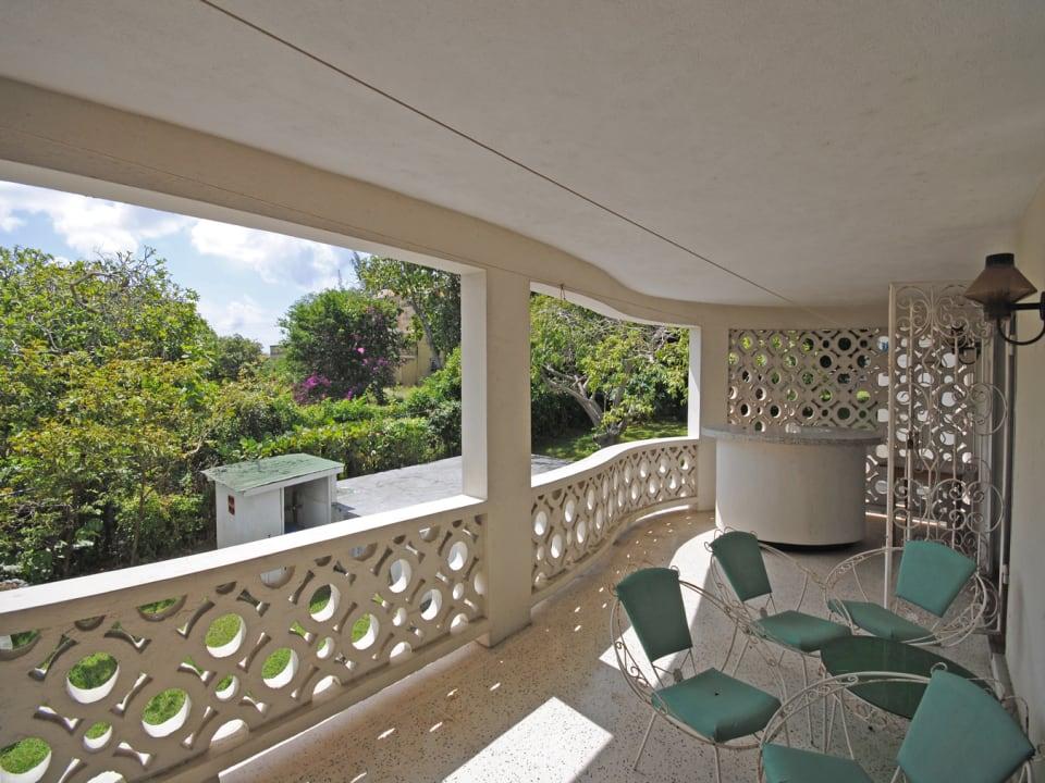 Patio of residence overlooks garden