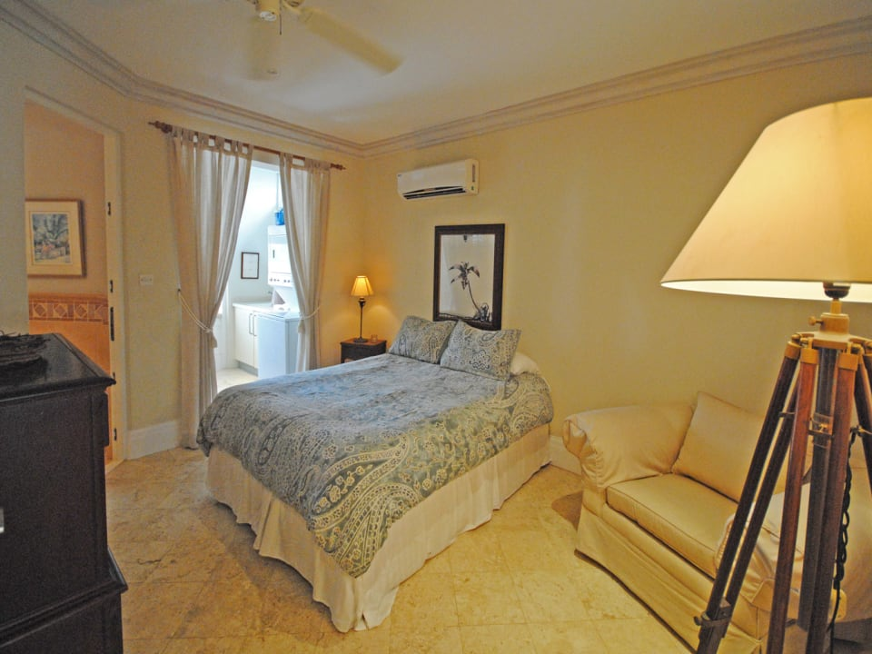 Ground floor guest bedroom opens to laundry and has ensuite bathroom