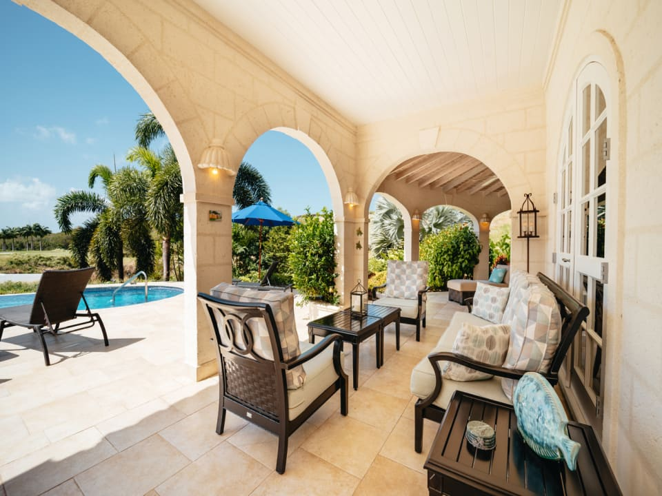 Covered patio overlooking the pool, golf and sea