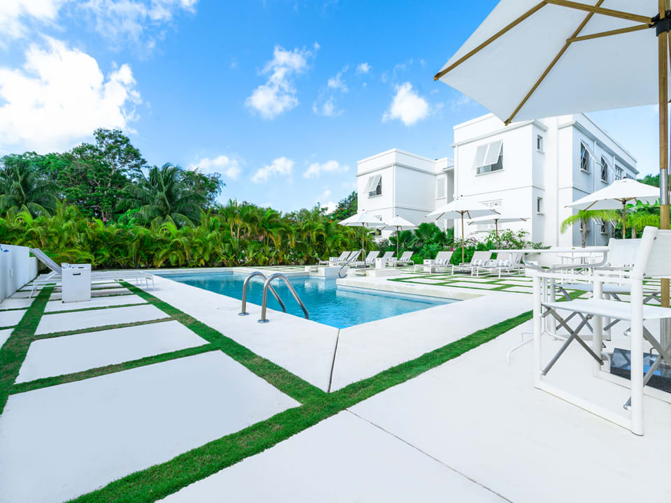 Pool deck showing lush greenery surrounding Mullins Grove