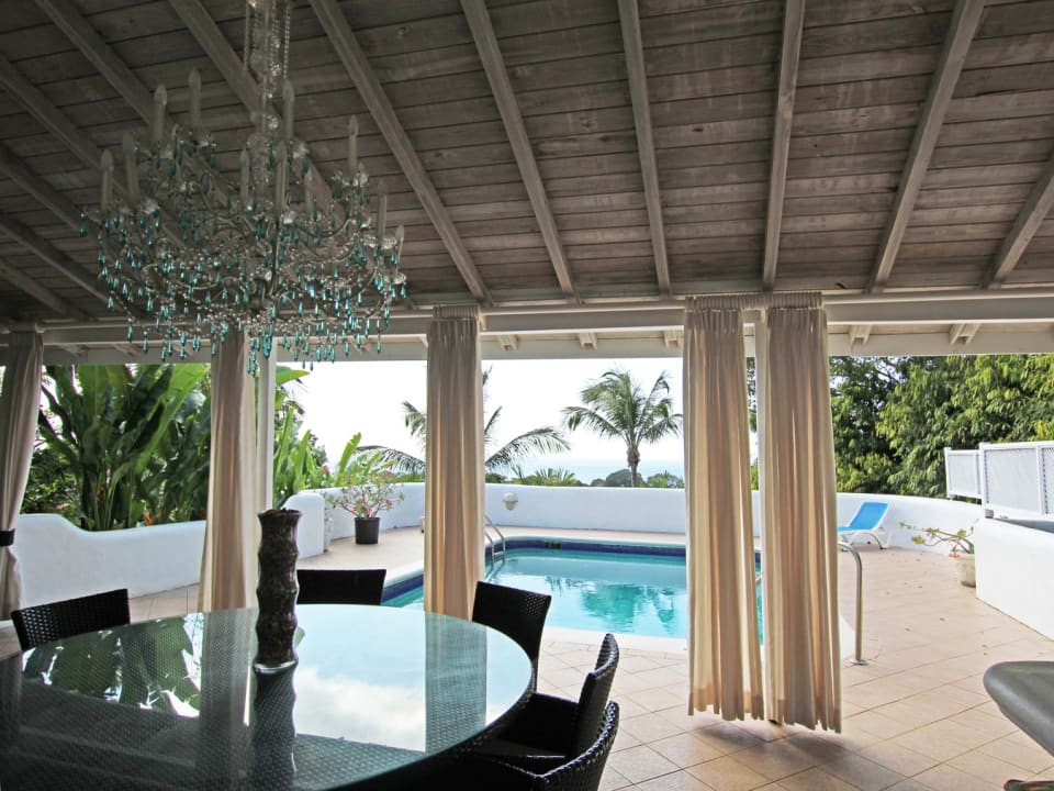 Blue Marine House. External patio terrace overlooking the pool area out to the Caribbean Sea.