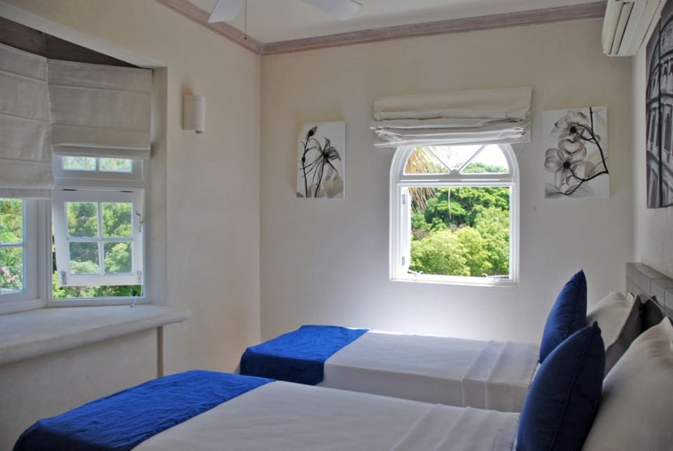Second bedroom with large windows