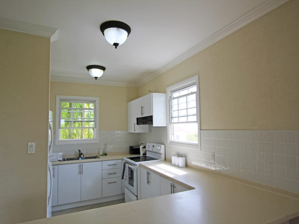 Fully fitted kitchen which opens out to the living space and outside terrace