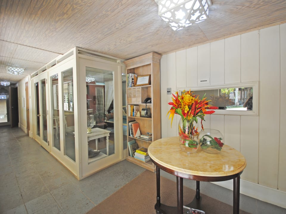 Foyer leads to reception and storage