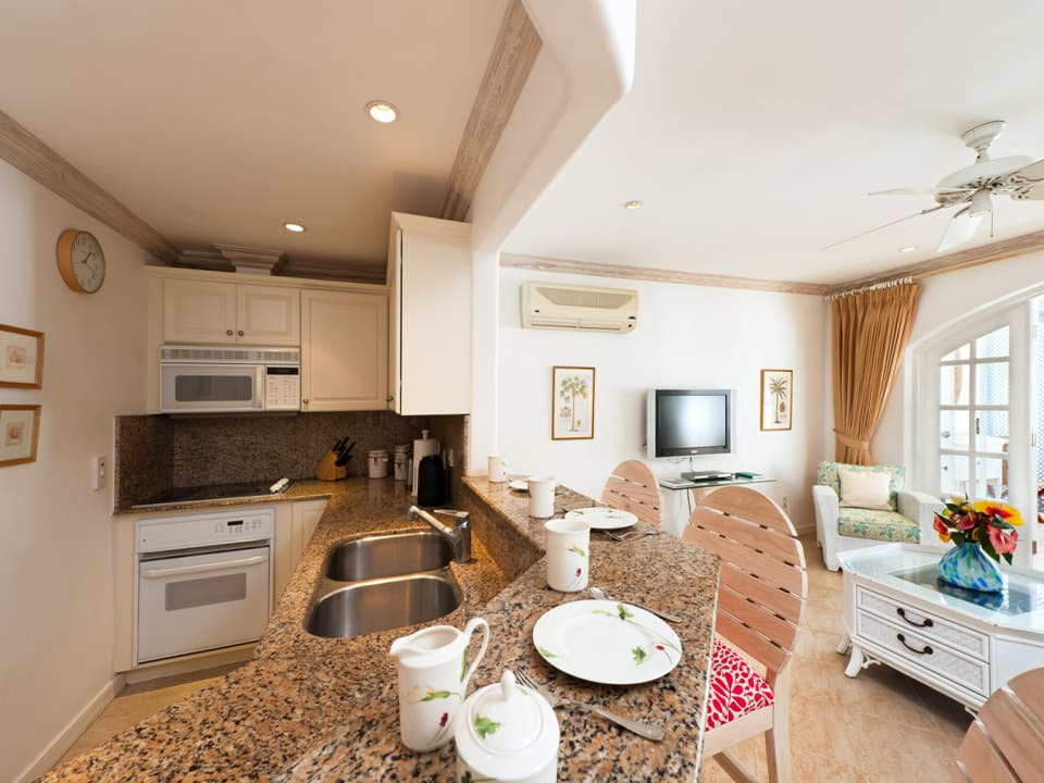 Well equipped kitchen with sit up bar and living room