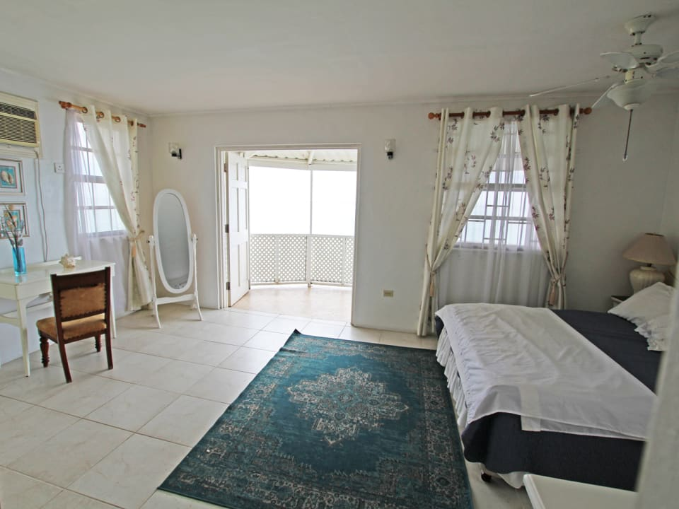 Upstairs bedroom suite with balcony