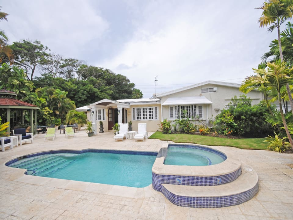 View of swimming pool, jacuzzi and poolside gazebo