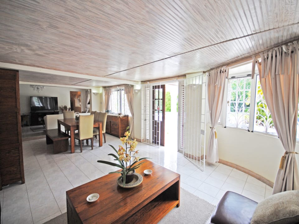 Open plan living TV and dining opens to pool terrace
