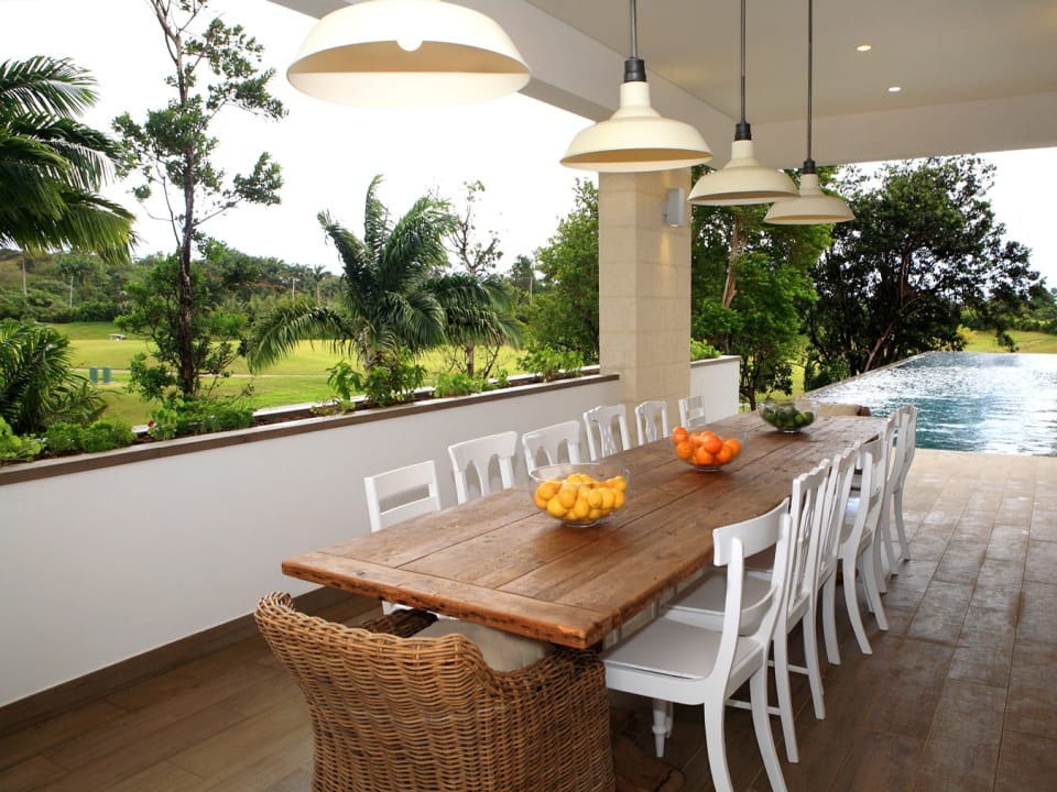 Dining area overlooking the pool