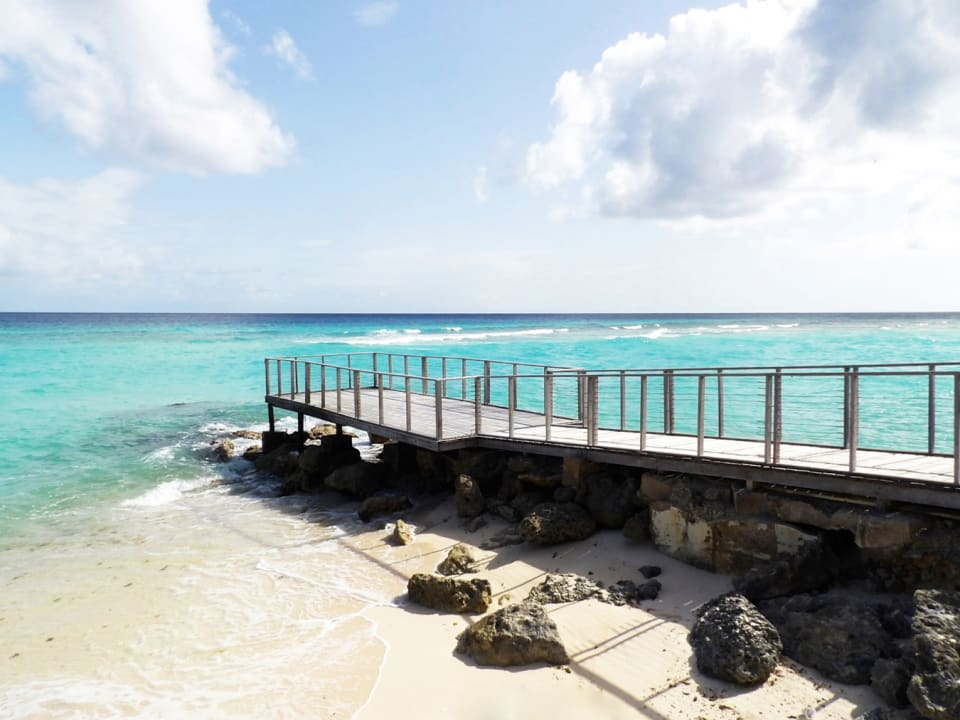 White sandy beach with jetty