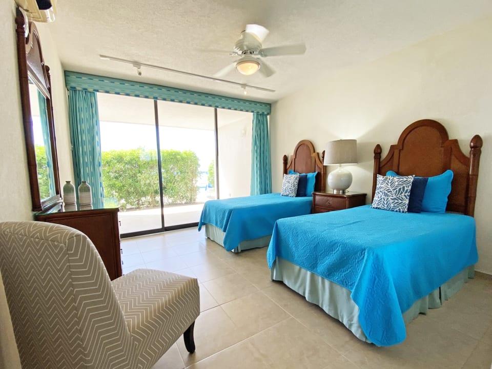 Guest bedroom with door leading to patio