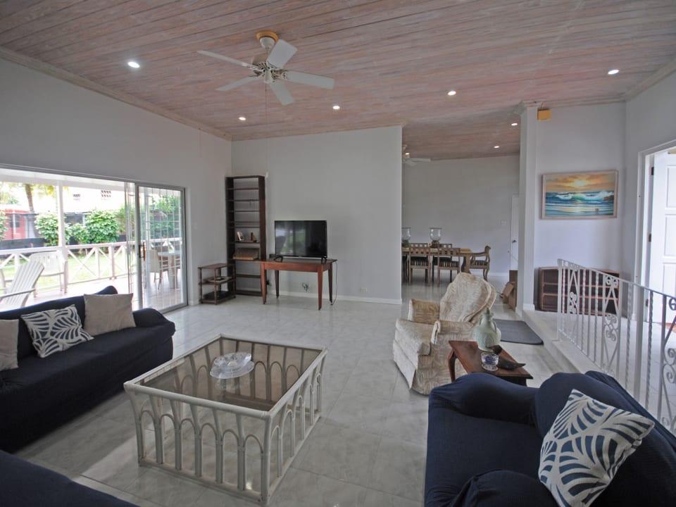 Living room opens to the verandah through glass sliding doors