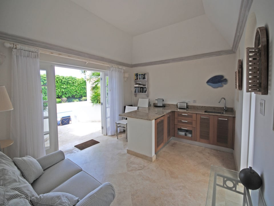 Cottage sitting room and kitchenette open to pool terrace