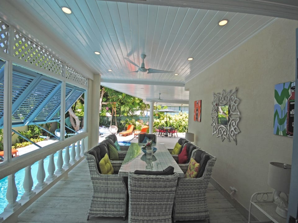 Dining veranda overlooks pool
