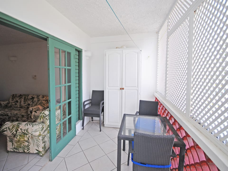 Enclosed veranda of No 8 which is on the ground floor at the end of the building