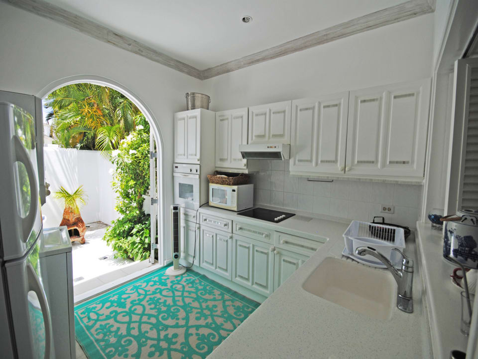 Well equipped kitchen opens to courtyard