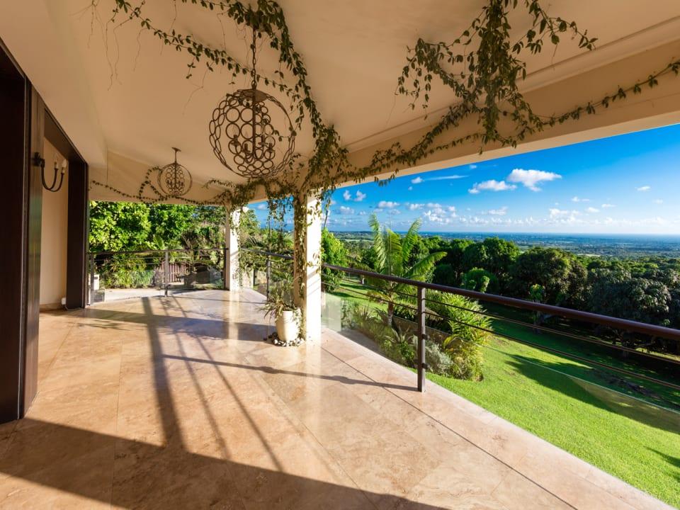 Verandah overlooks the Mango farm and sea view beyond