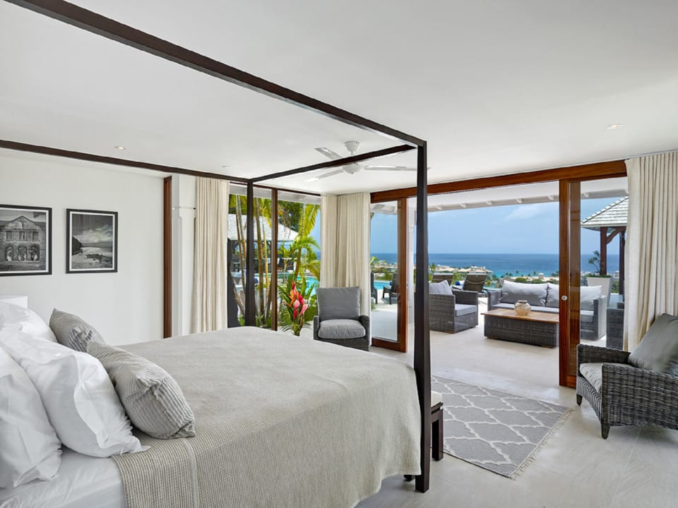 Main bedroom on ground floor opens to sitting area and swimming pool