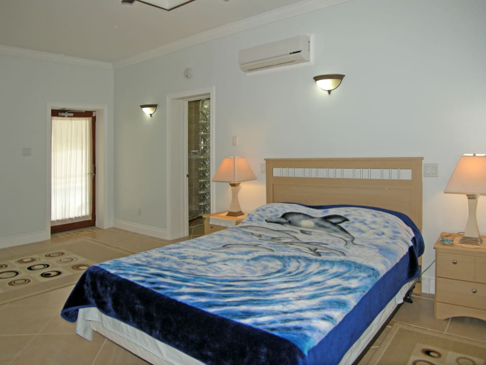 Bedroom with A/C and Fan